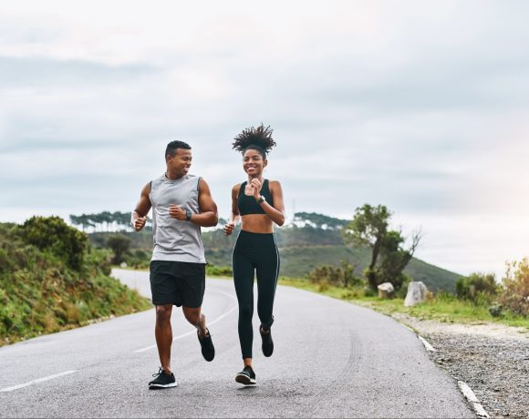 sporty couple exercising outdoors
