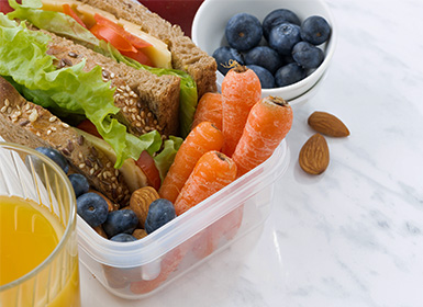Sandwich and vegetables and berries and nuts