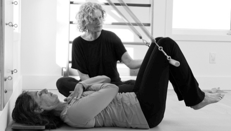 Photo of Heather Dennis working with student
