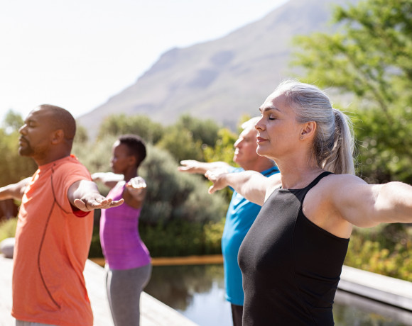 work life balance one year in a pandemic, group of mature people doing Pilates